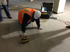 ETI technician demonstrating use of GPR equipment.